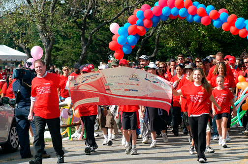 Global Television's Bill Coulter left leads off Toronto SuperWalk's largest turnout ever, with Celebrity Lauren Collins (right) under sunny skies.