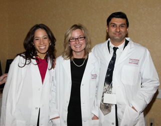 Dr. Mandar Jog with Speech langauge pathologists Angie South (middle) and Stephanie Somers (left)