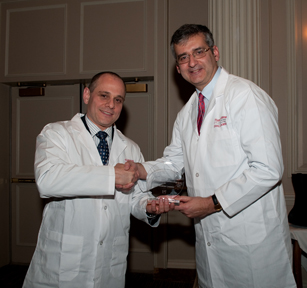 Dr. Ted Fon, Chair, Parkinson Society Canada's Scientific Advisory Board and Chair, Donald Calne Selection Committee presents Dr. Andres Lozano with the Donald Calne Award in Ottawa.