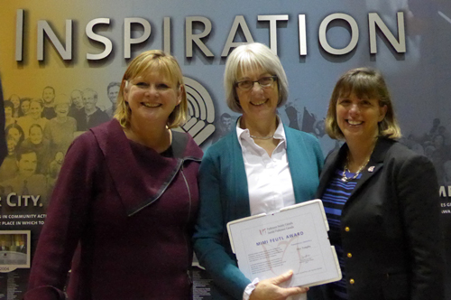 Alice Templin, centre, receives her award from Dennise Taylor-Gilhen, CEO, Parkinson Society Eastern Ontario, left and Vanessa Foran, VP, Public Affairs & National Programs, Parkinson Society Canada.