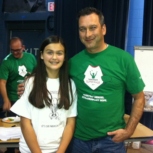Jenna Sigurdson, 13, with Marc Pittet, Parkinson Society Manitoba (PSM) Board Chair, at the Parkinson SuperWalk in Winnipeg, where she received the Spirit of  Philanthropy National Volunteer Award. Jenna has raised more than $40,000 for PSM.