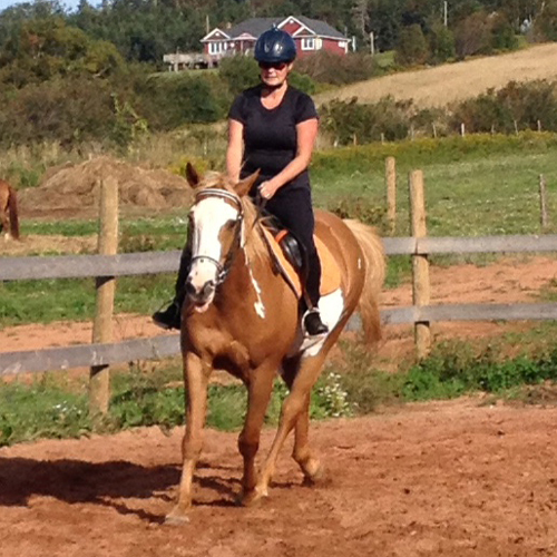Natasha McCarthy and TBone get some exercise at Giddy up Acres in PEI.